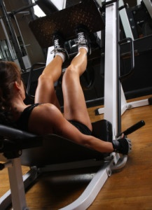 Female bodybuilder working out at the gym.